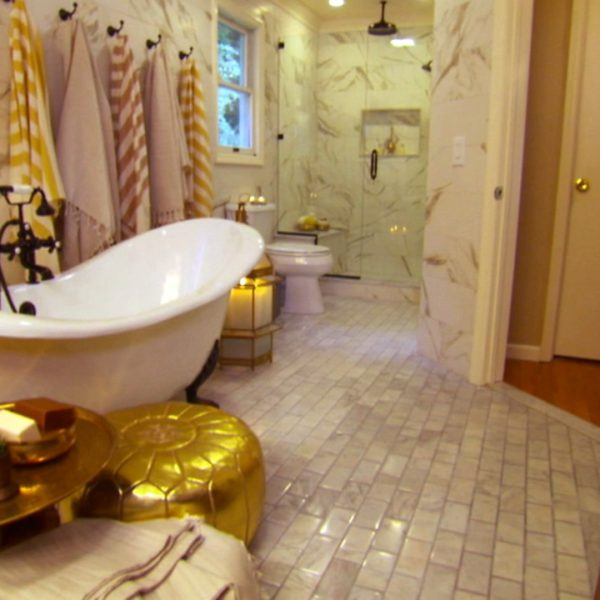 The claw foot bathtub is the focus in this master bathroom.